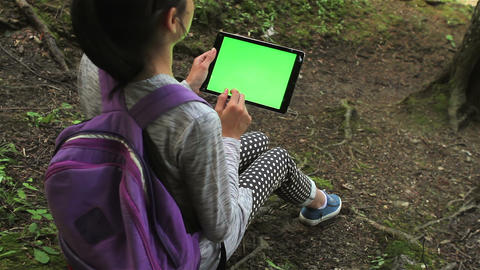 Teenage girl using tablet pc with green screen Footage