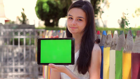Student Girl Shows Tablet Pc At Camera stock footage