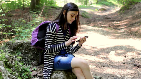 Teenager girl tourist using smartphone Footage