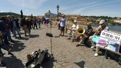 Street musicians, band plays on the Charles Bridge in Prague Footage