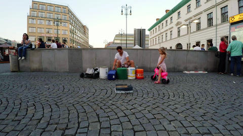 A street musician plays the buckets, drums in Prague. 4K Footage