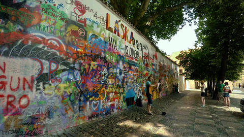 Painted graffiti wall in Prague. Lennon Wall. 4K Live Action