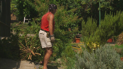 Workman Moves Tree Clippings stock footage