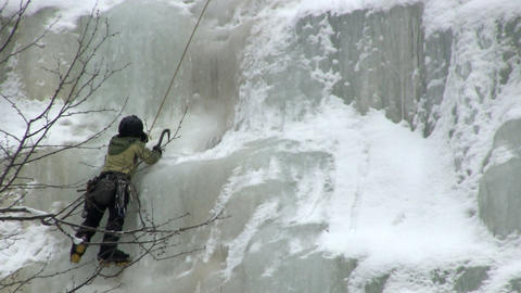 Climber turns ice screw Footage