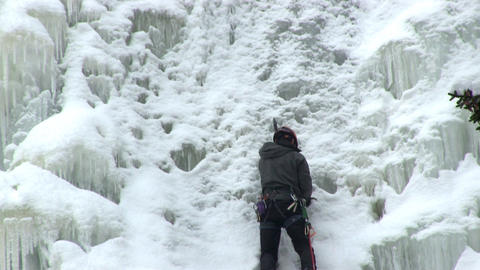Setting an ice screw into ice wall Footage