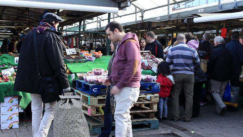 People visiting and buying fruits at the outdoor market Footage