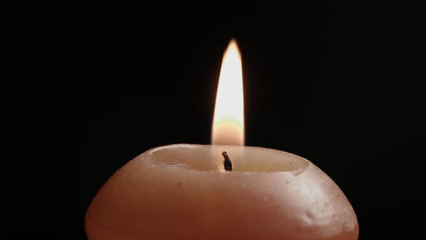 1080p Ungraded: Spinning Candle Close-Up on Black Background Footage