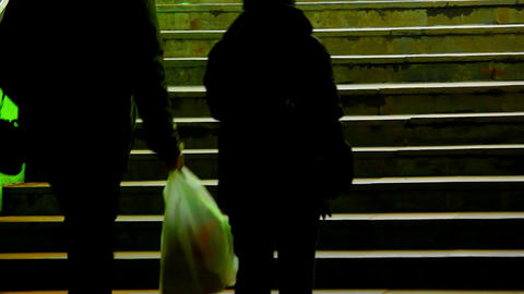 1080p Couple on Dark Green Subway Staircase Footage
