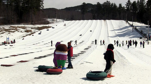 Montain snow tubing mascots in costumes Footage