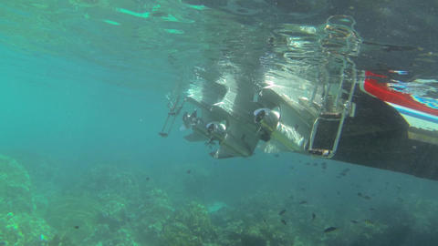 Speed boat outboard motors at a coral reef underwater shot Live Action