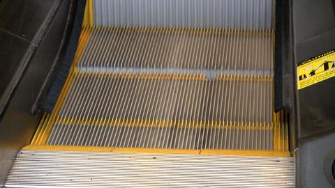 Feet on escalator Footage