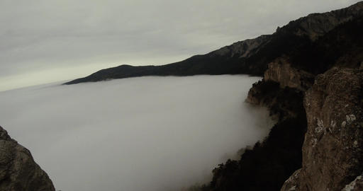 fog like the sea washes over the rocks mountain spring Footage