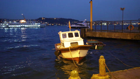 Motor boat and boat shake on waves near mooring in evening, Istanbul, Turkey Footage