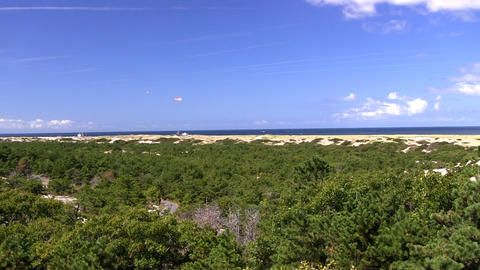 Pan from left to right of race point beach and Atlantic ocean from high vantage  Footage