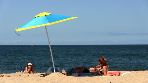 Couple Under Beach Umbrella stock footage