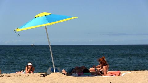 Couple under beach umbrella Footage