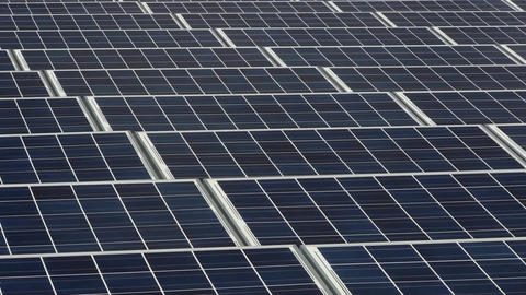 Zoom Out Of Solar Panel Grid On Rooftop Of Manufacturing Facility On Cape Cod stock footage