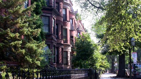 Beautiful brownstone buildings on beacon street in Boston on summer day with gre Footage