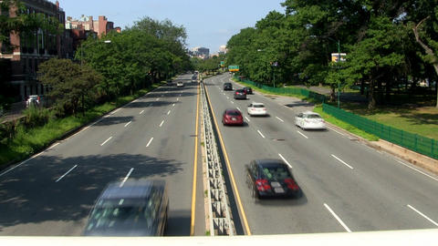 Storrow drive along Charles river in Boston from footbridge overpass on hot summ Footage