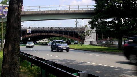 Traffic winds its way along storrow drive in Boston near Charles river Footage
