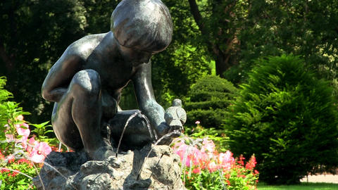 Boy and bird fountain at Boston public garden captures interaction with natural  Footage