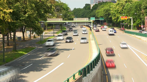 Time-lapse of traffic along storrow drive in Boston on summer day Footage
