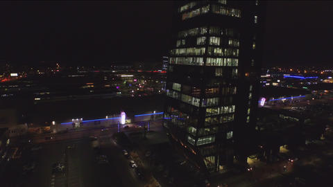 AERIAL: Businessman working in big office skyscraper at night Footage