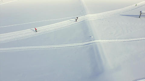 AERIAL: Cross country skiers in winter Footage