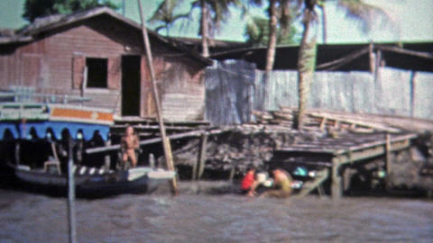 1973: Fast boat ride thru rural Southeast Asian waterway countryside Footage