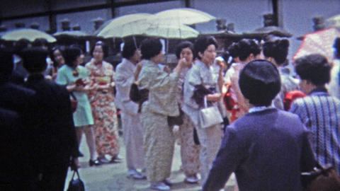 1972: Women walking to a function in traditional Japanese kimono dress Footage