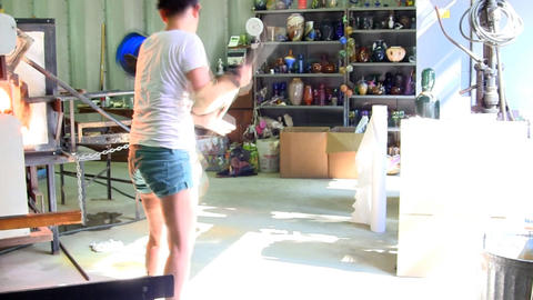 Japanese glass artist reheats vase in furnace then spins blowpipe like baton to  Footage