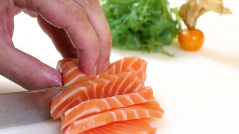 Sushi Chef Slices a Salmon Steak Nigiri Style Footage