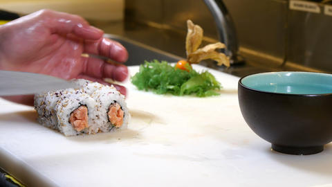 Sushi Chef Cutting Salmon Uramaki Roll 4k stock footage