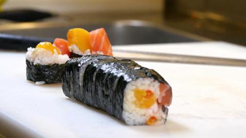 Sushi Chef Presenting Salmon Peach Futomaki Roll Live Action