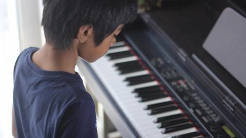 Boy Practicing Piano stock footage