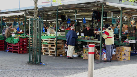 Pensioner Female Shopping In Outdoor Market stock footage