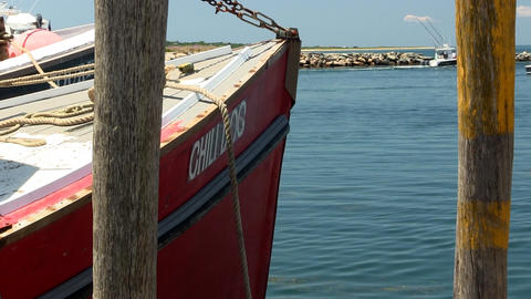 Front of red fishing boat docked at fishing village of Menemsha on Martha's Vine Footage