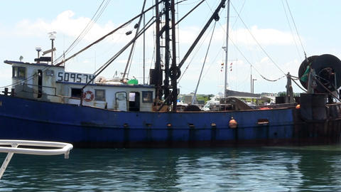 Large fishing trawler boat pulls into Menemsha harbor to unload catch on Martha' Footage