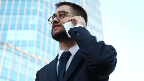 Businessman Talking On Mobile Phone. Bottom view. Dolly Shot Footage