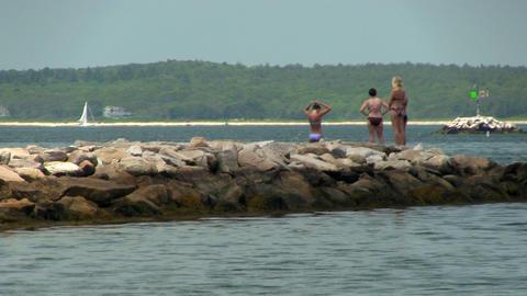 Girls on rocks in bikinis Footage