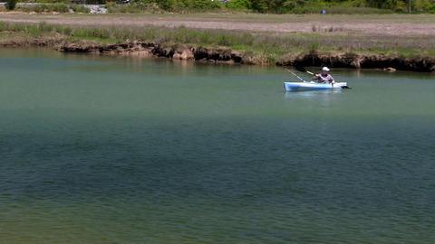 Kayaker fishing Scorton Creek Sandwich Cape Cod Footage