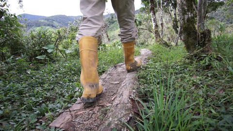 Man Rubber Boots Trail Low Angle Going Footage