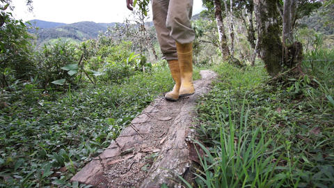 Man Rubber Boots Trail Low Angle Coming Live Action