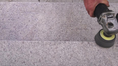 Man with grinder polishing stone stairs Footage