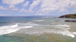 Pan of Hawaiian beach during bright day Footage