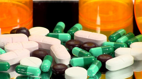 Drugs And Medicine; Capsules, Pills And Tablets On Mirror; 2 stock footage