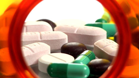 Drugs and Medicine; capsules, pills and tablets from inside bottle; 3 Footage