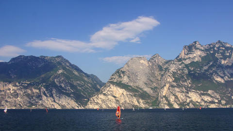 Surfing On Garda Lake In Dolomites stock footage