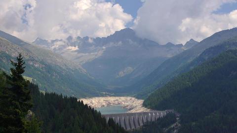 Malga Bissina lake with hydro station in Dolomites Footage