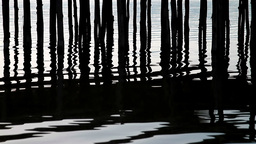 Rippling lake and wooden posts Stock Video Footage